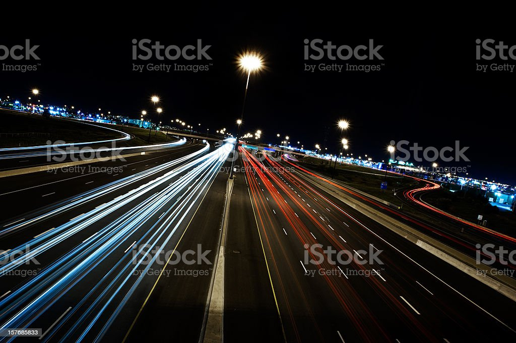 Motion-blurred view of cars on the highway at night royalty-free stock photo
