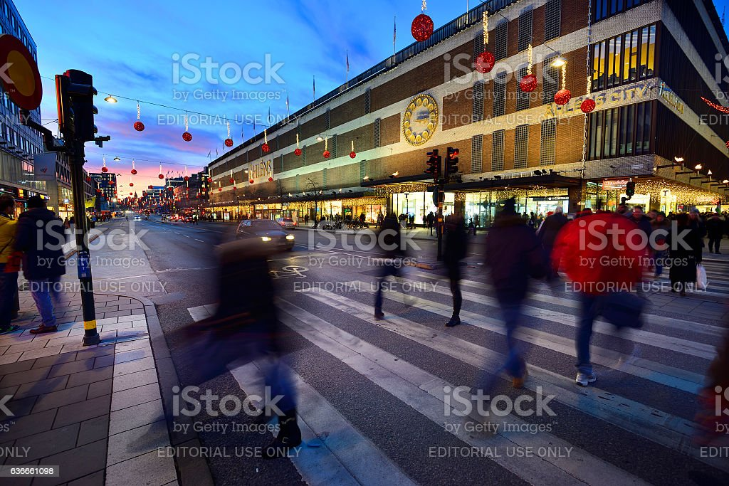 Motiuon blurred pedestrians, just after sunset in Stockholm stock photo