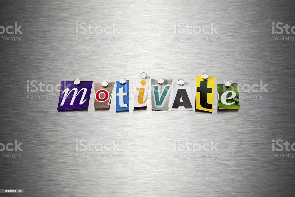 Motivate On Brushed Metal royalty-free stock photo