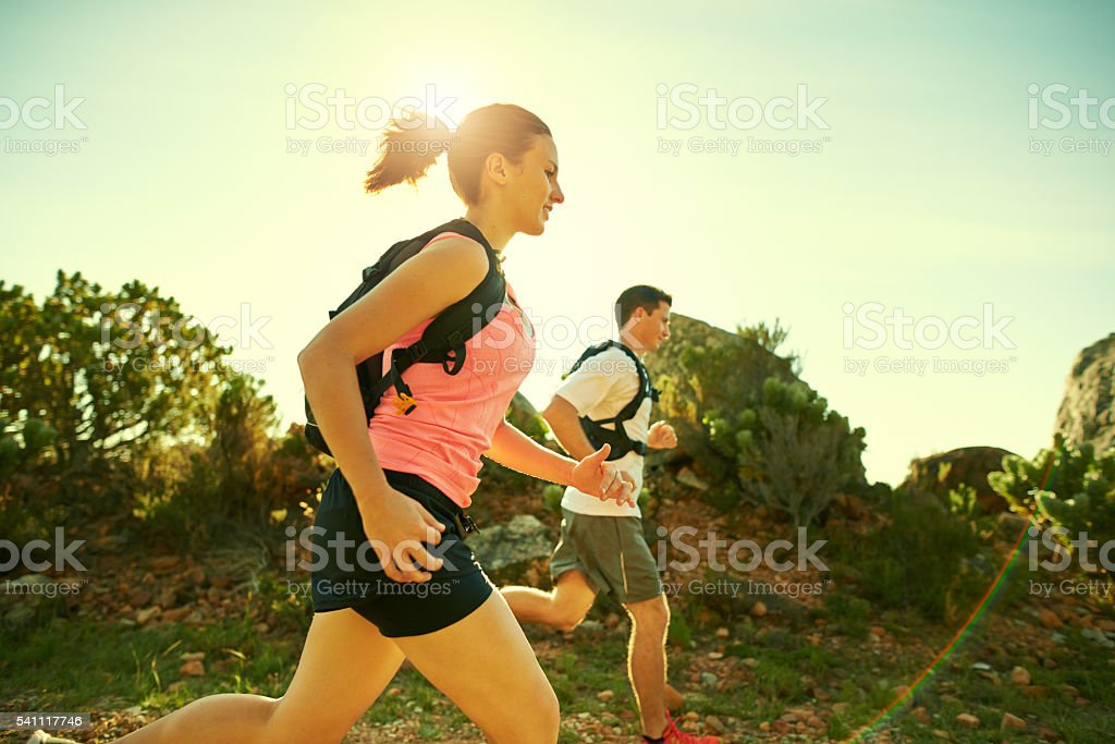 Motivation is the key to conquering the mountain stock photo
