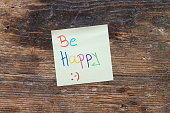 Motivation message Be happy on wooden table