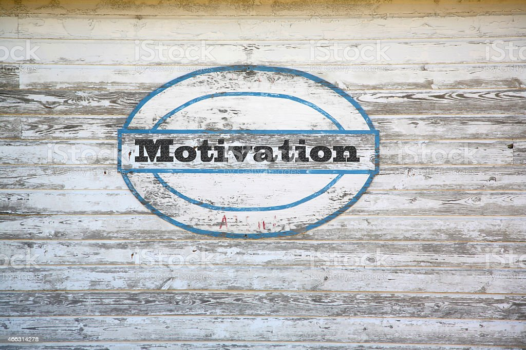 Motivation sign on shed stock photo