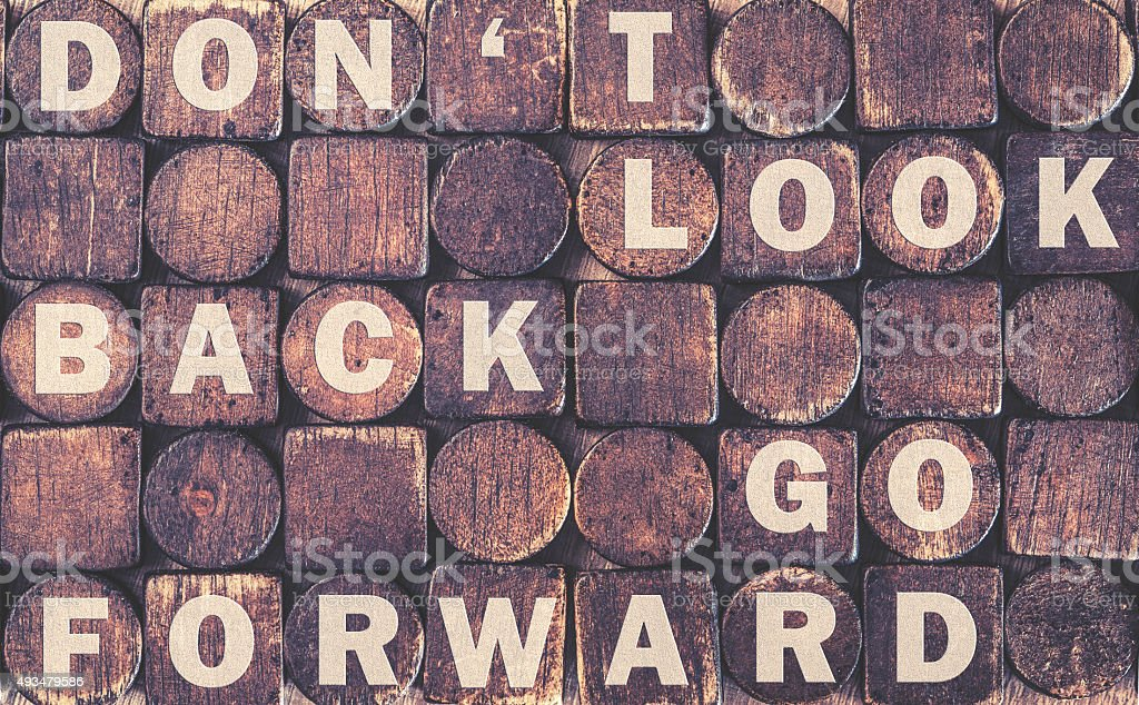 Motivational message on a wooden surface stock photo