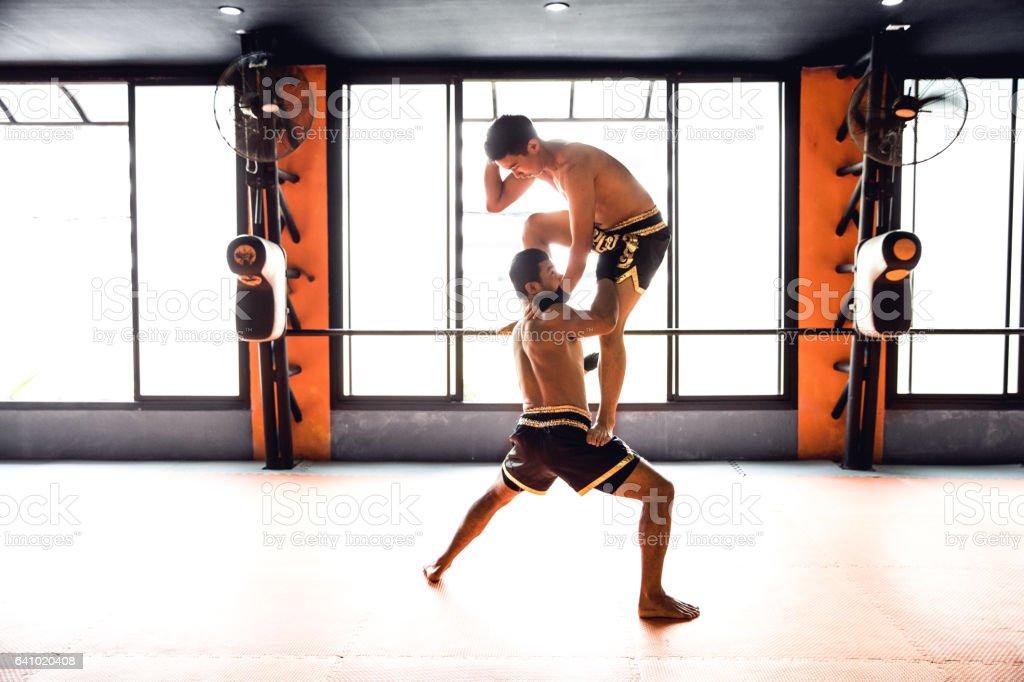 Motivational Muay Thai training at the gym facility stock photo
