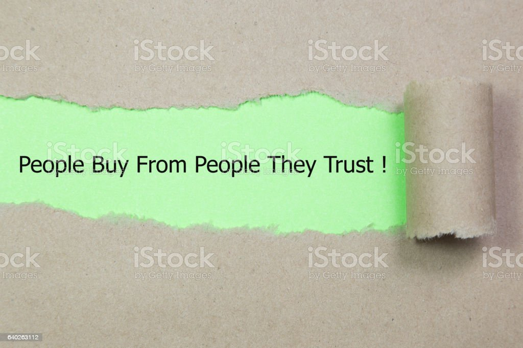 Motivational quote People Buy From People They Trust stock photo