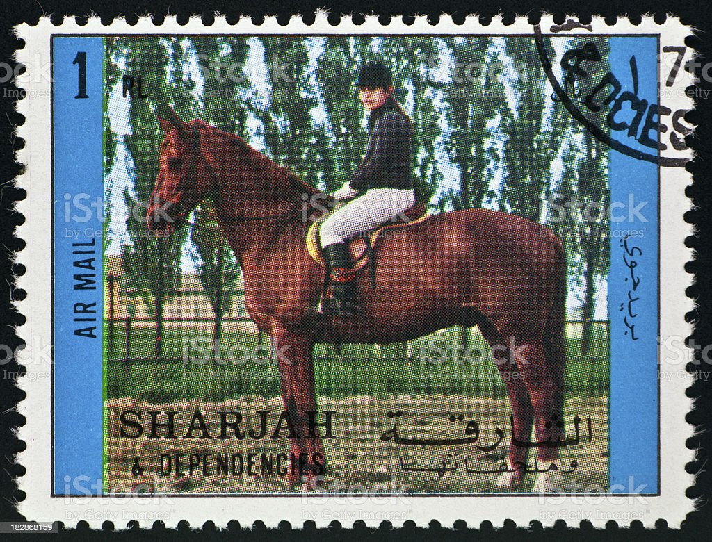 Motive stamp with horse and rider - Sharjah arab emirates stock photo