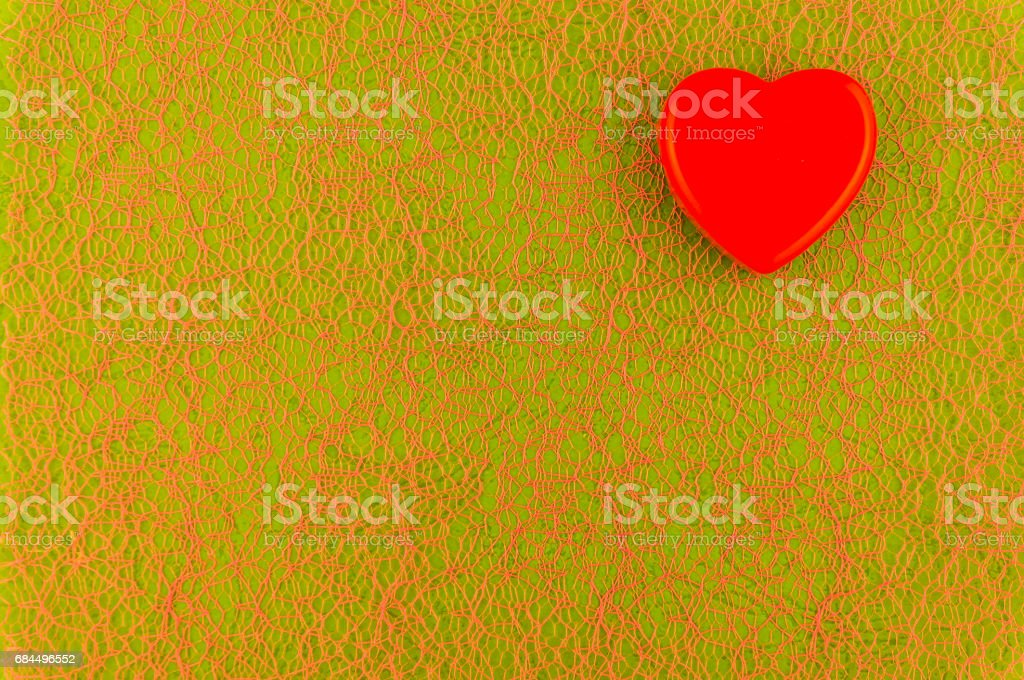 Motley green background with red threads. stock photo