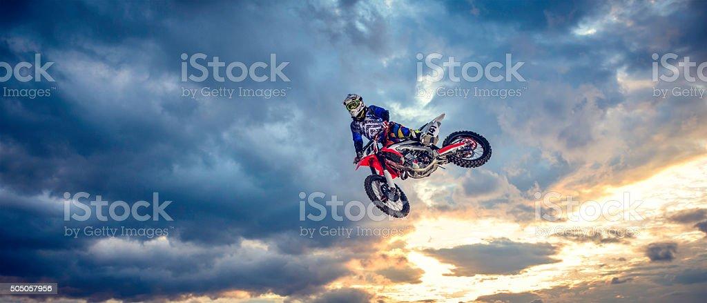 Motocross biker in the air stock photo