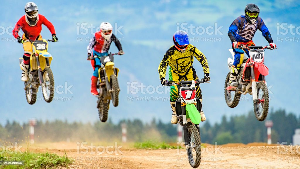Motocross bikers in the air stock photo
