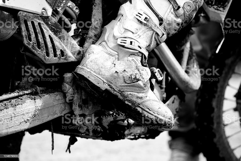Motocross Boot with Mud, Black and White royalty-free stock photo