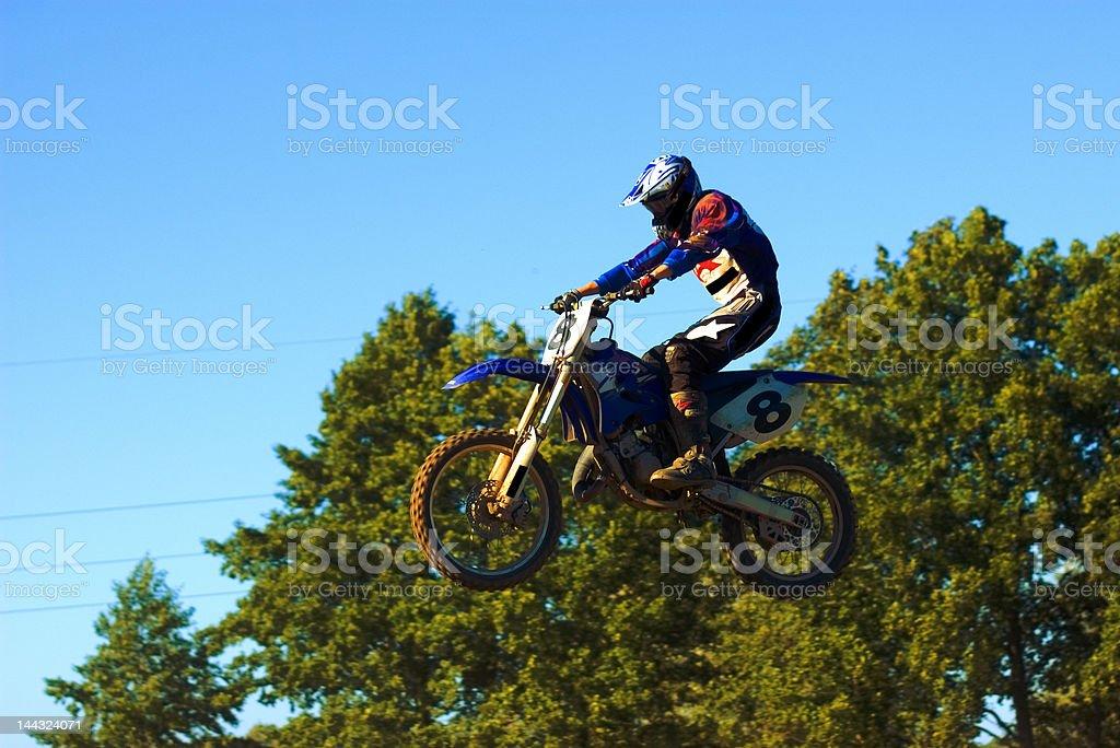 Motocross guy flying stock photo