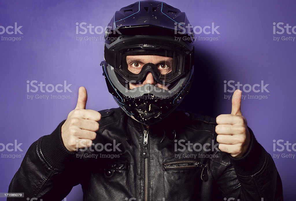 Motocross Motorbike Rider with Dirty Helmet Thumb Up royalty-free stock photo
