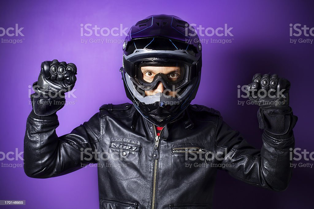 Motocross Motorbike Rider with Enduro Helmet Raised Fists royalty-free stock photo