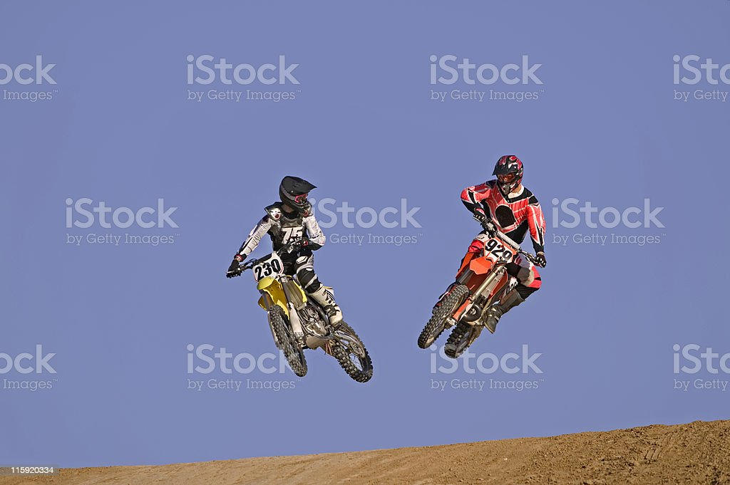 Motocross Racers Jumping Together royalty-free stock photo