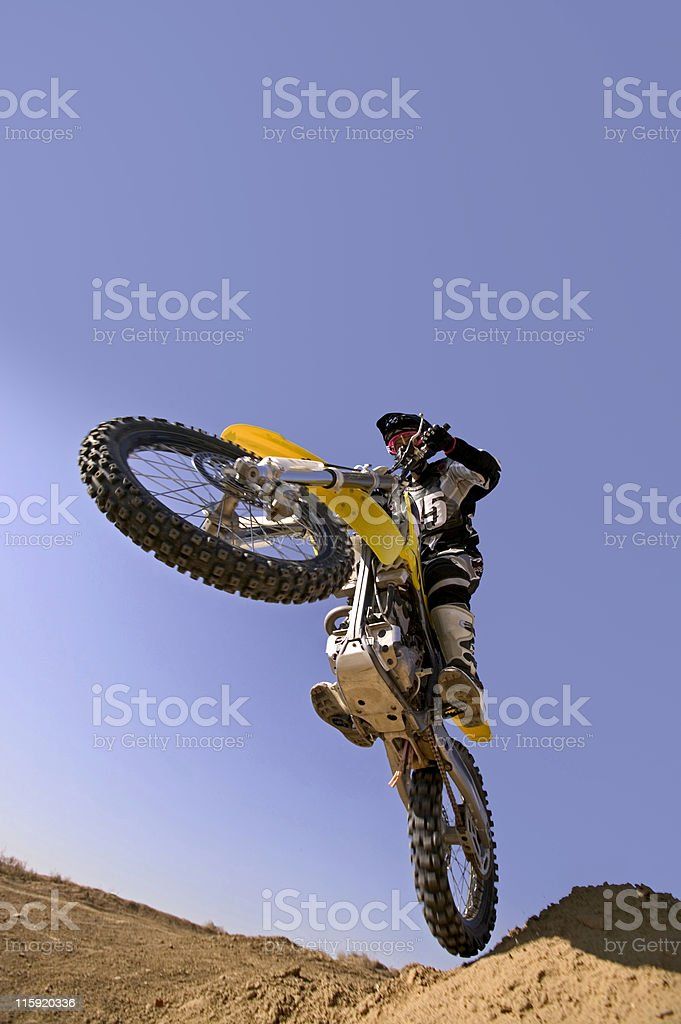 Motocross Rider Jumping Against Blue Sky royalty-free stock photo