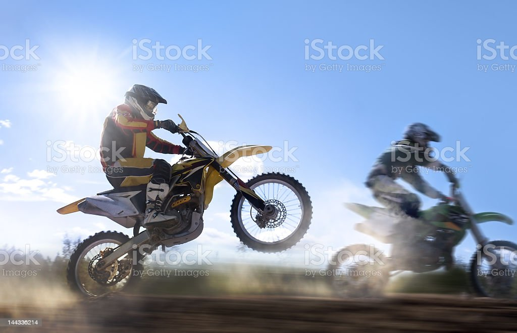 Motocross rider pulling a wheelie stock photo