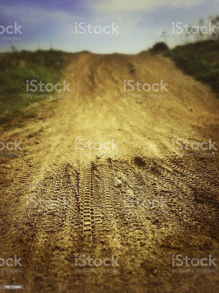 Motocross Tire Track on Muddy Ground stock photo