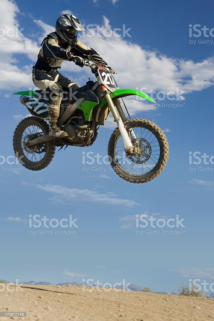 Motocross-rider jumping royalty-free stock photo