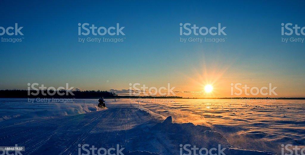 Motoneige, Coucher de soleil stock photo