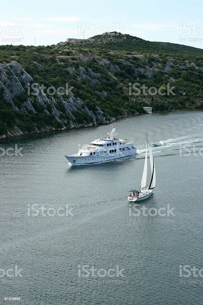 Motor and sailing boat in Sibenik canal-Croatia royalty-free stock photo