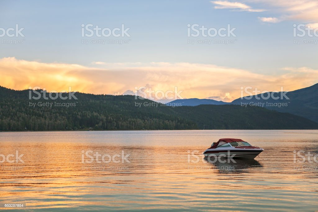 Motor boat anchored in the water on Shuswap Lake stock photo