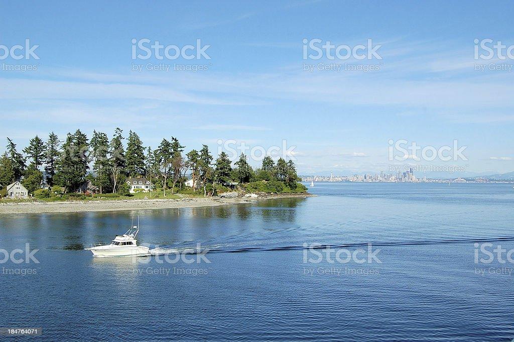 Motor Boat Entering a Harbour in Bainbridge Island stock photo