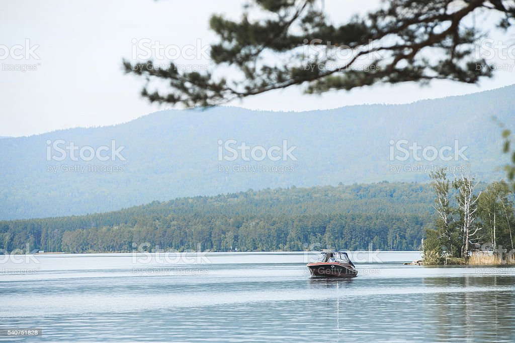 motor boat floats on water of lake royalty-free 스톡 사진