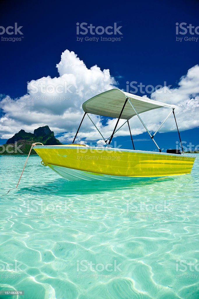 Motor Boat in Atoll Lagoon Waters royalty-free stock photo