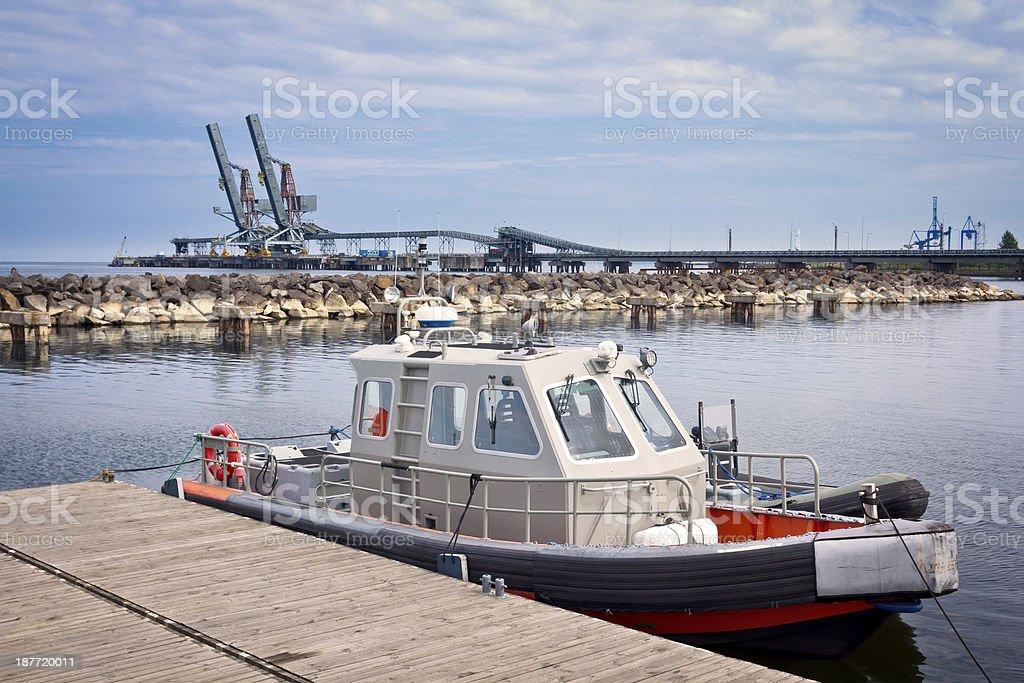 Motor boat in harbor royalty-free stock photo