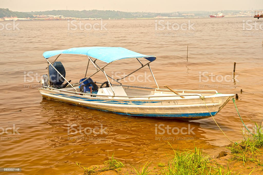 motor boat on dirty water stock photo