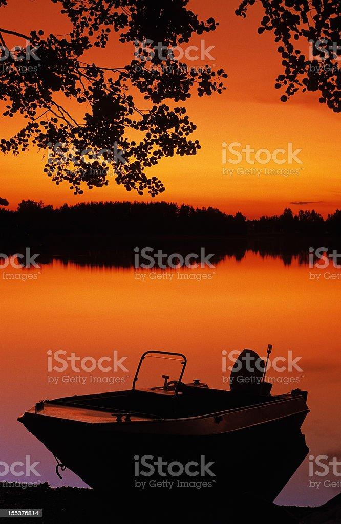 Motor boat on shore royalty-free stock photo