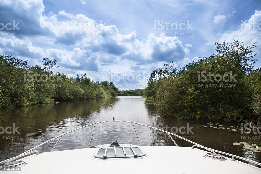 motor boat view of the Norfolk Broads England stock photo