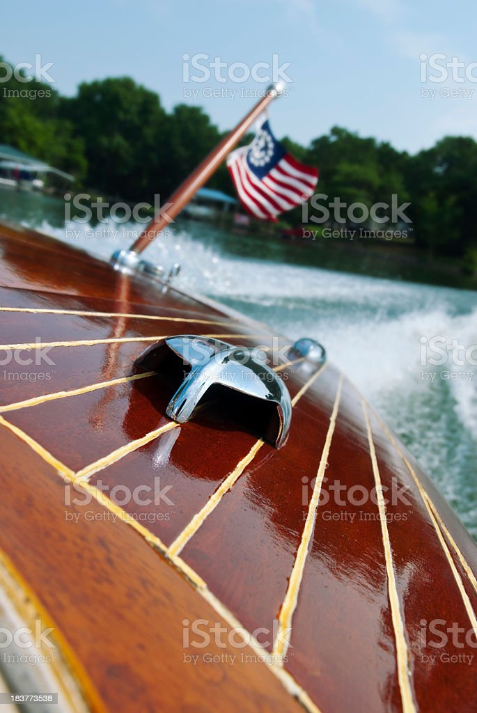 Motor boat with a flag blowing in the wind stock photo