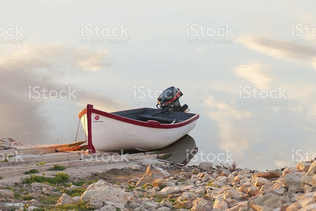 Motor boat with clouds royalty-free stock photo