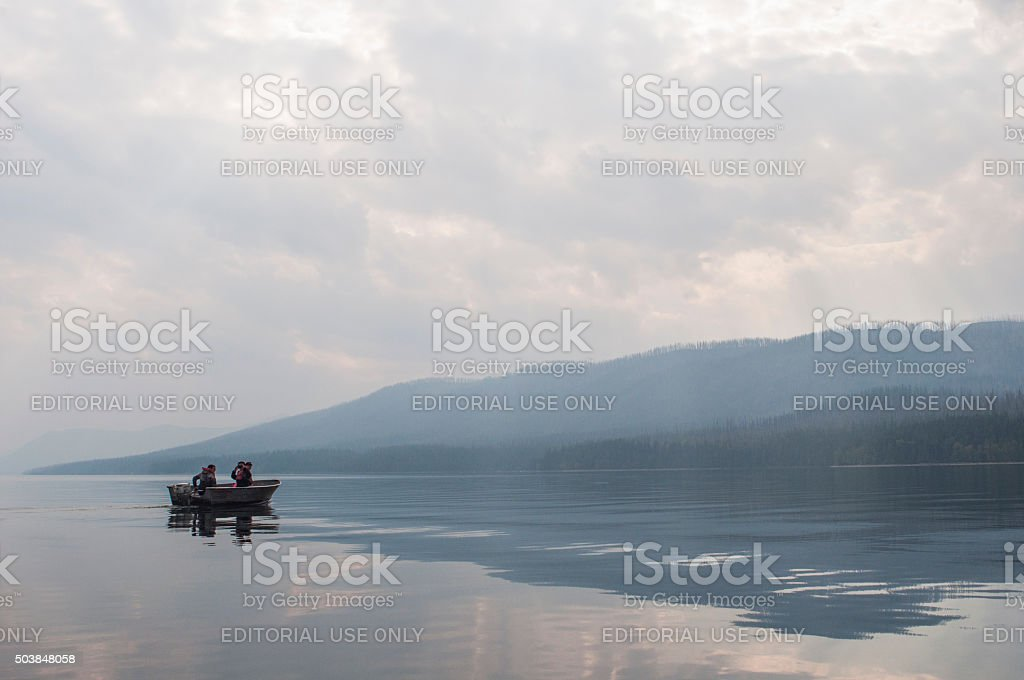 Motor boating in Lake McDonald stock photo