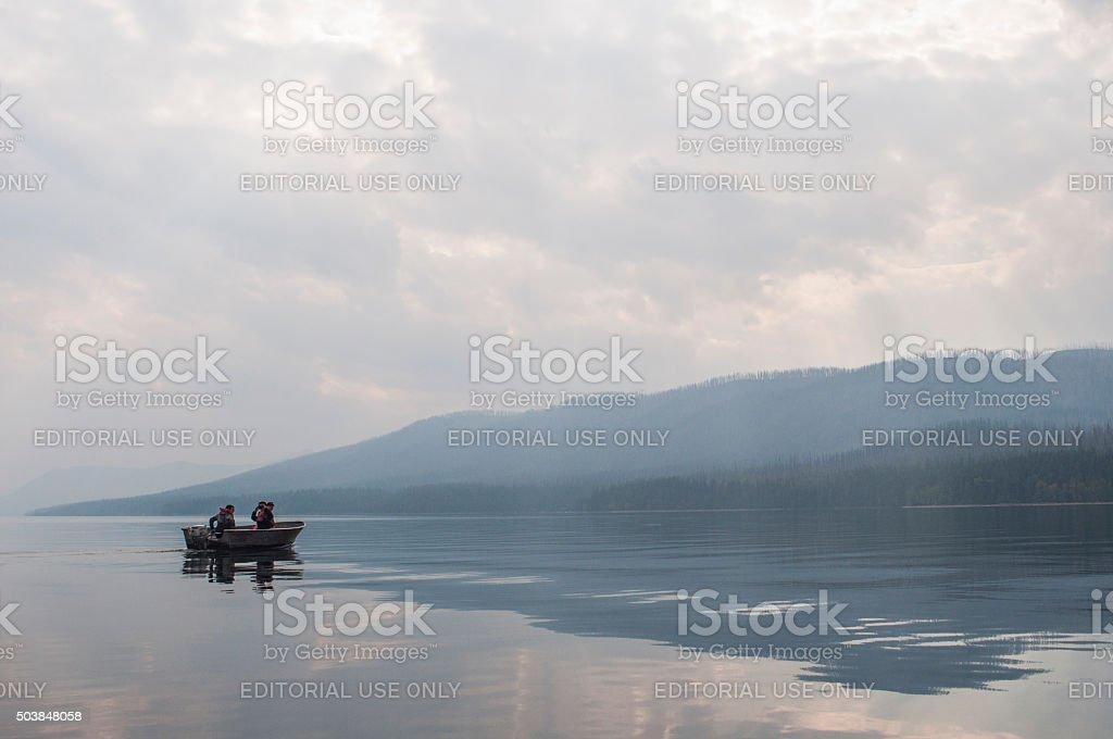 Motor boating in Lake McDonald stock photo