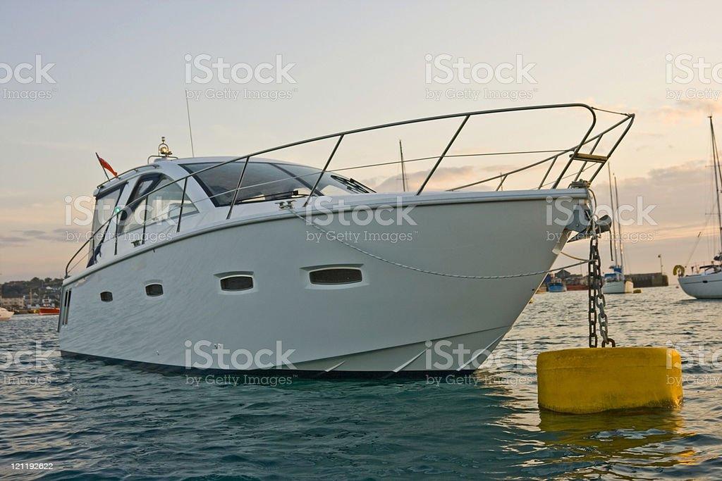 Motor cruiser at sunset royalty-free stock photo