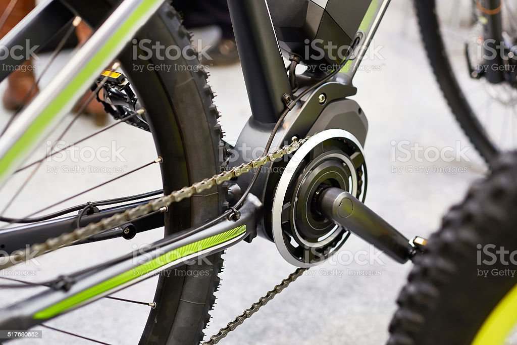 Motor electric bicycles in front of carriage pedals stock photo