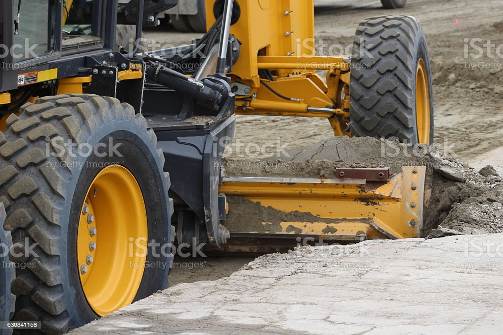 Motor Grader leveling dirt stock photo