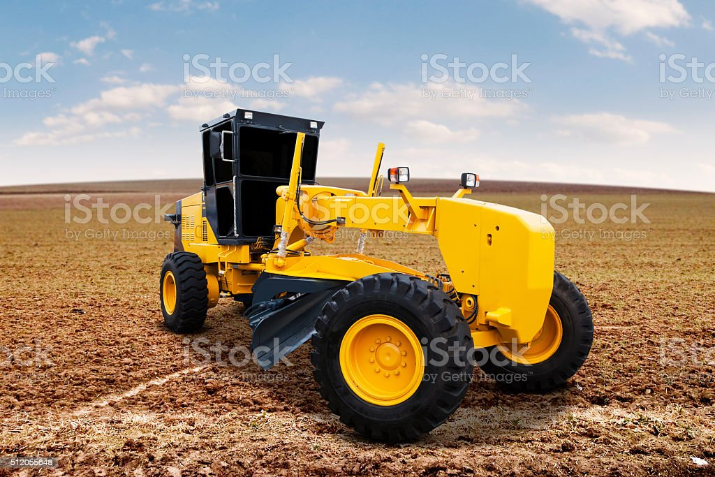 Motor grader on the road construction stock photo