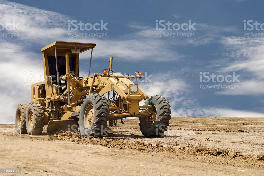 Motor grader working on road construction stock photo