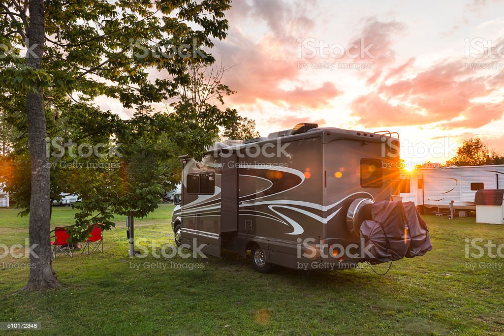Motor home, camping at sunset stock photo