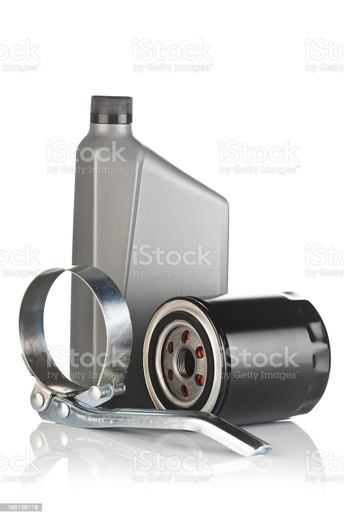Motor oil bottle, filter wrench and oil filter on isolated on white royalty-free stock photo