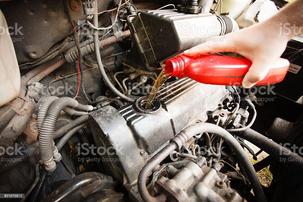 Motor oil, car engine close up stock photo