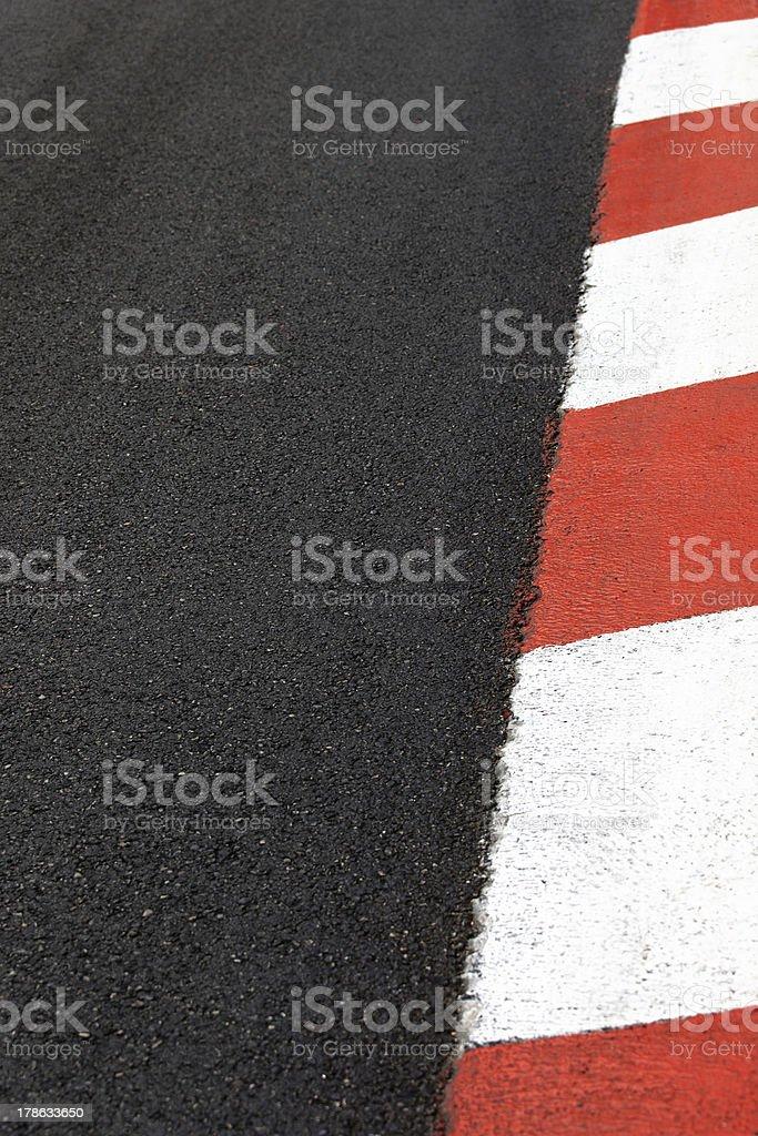 A motor race asphalt curb on the Monaco Grand Prix circuit royalty-free stock photo