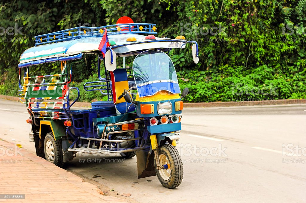 Motor tricycle car service in Laos stock photo