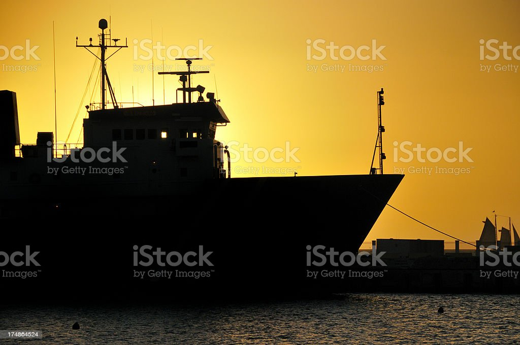 Motor Vessel in Sundown Silhouette royalty-free stock photo