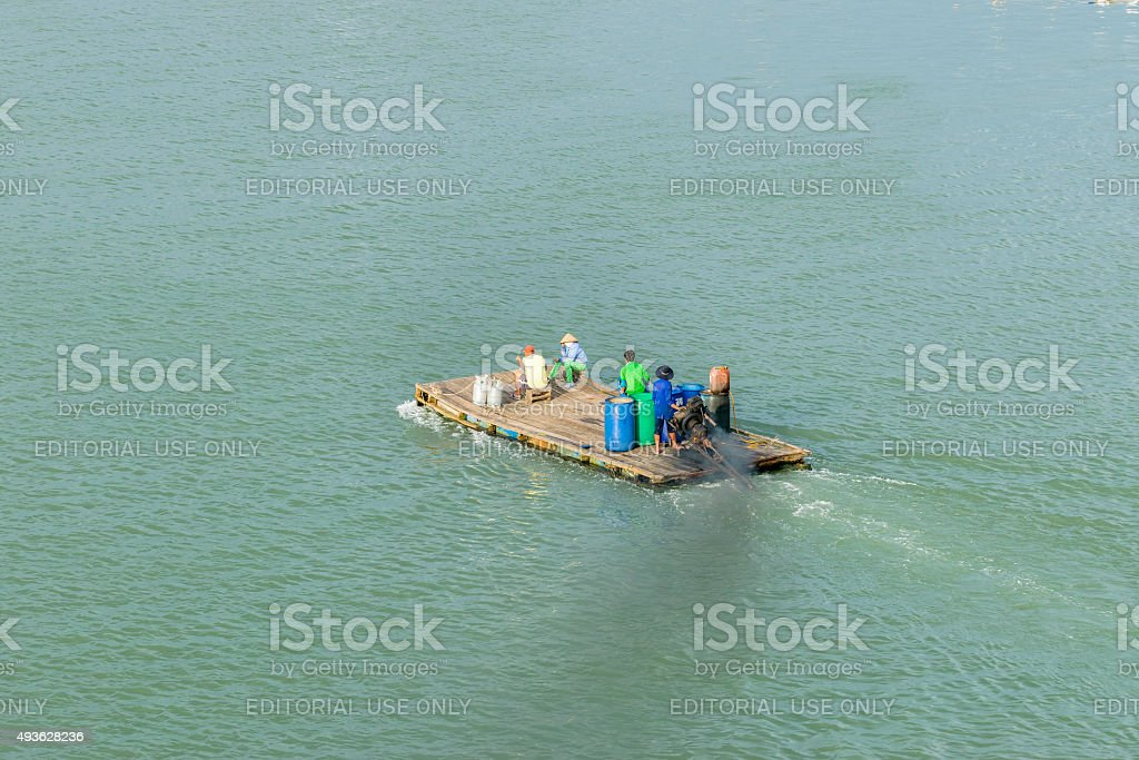 Motor wooden raft crossing the river stock photo