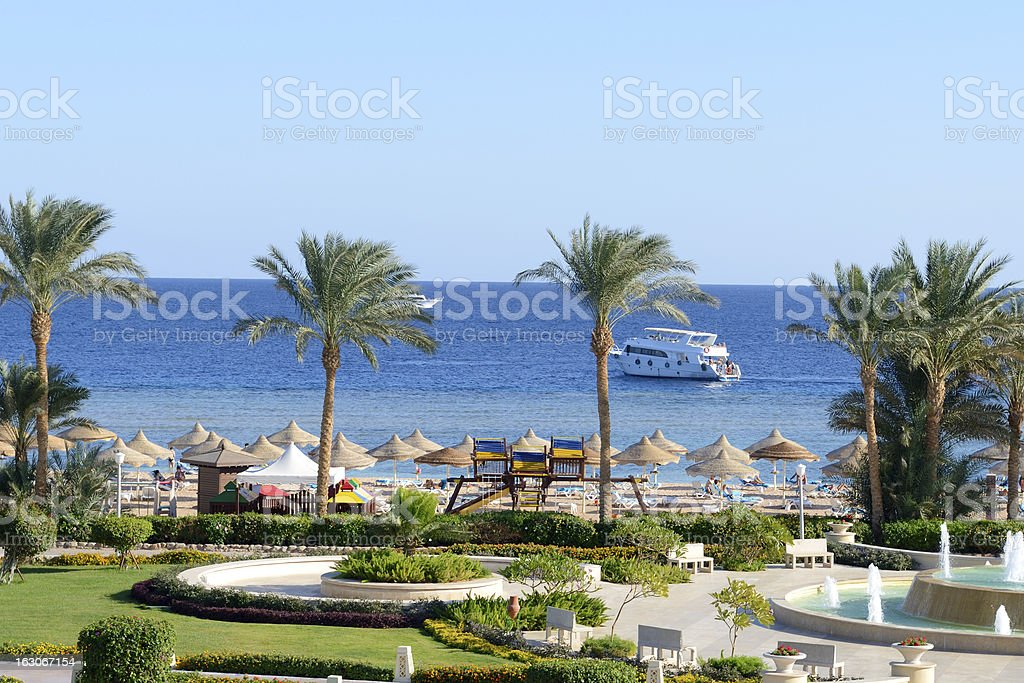 Motor yacht and beach at the luxury hotel royalty-free stock photo