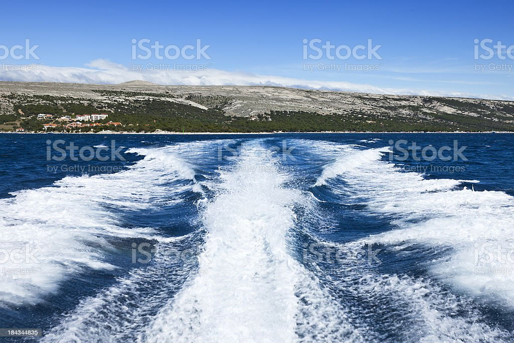 Motor yacht wakes stock photo